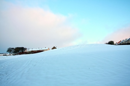 Snowy hill in a town photo