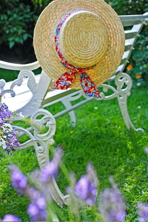 Peacuful summer garden with a hat photo