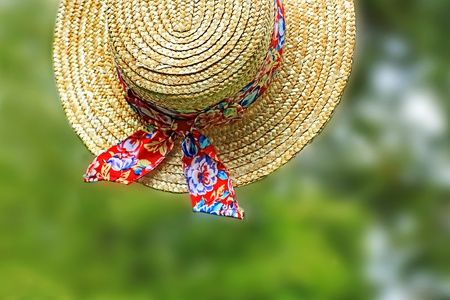 Lovely Summer straw hat in the garden photo