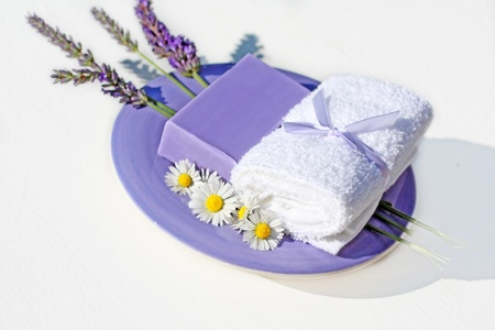 Lavender flowers and a soap on white background photo