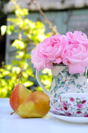 Morning in the garden with roses and pears