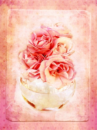 Vintage background with roses in the glass vase  photo
