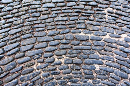 Old cobblestones background closeup photo