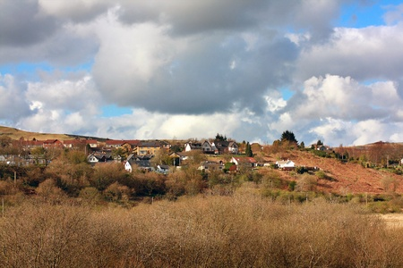 Scottish hills with houses in the countryside photo