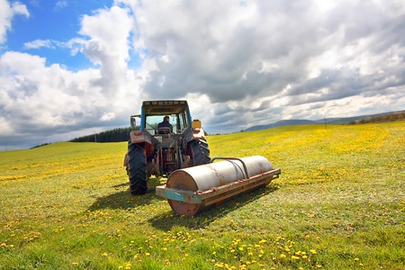 Spring farmwork in the fields on a sunny day Stock Photo - 13594847