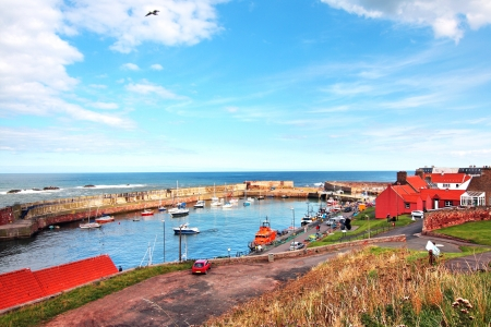 Old, fishing harbour panorama in Dunbar, Scotland, UK photo
