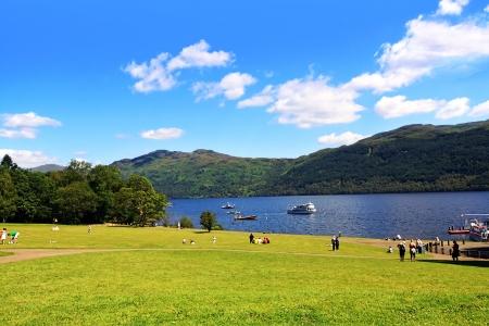 Tourists at Loch Lomond, Scotland photo