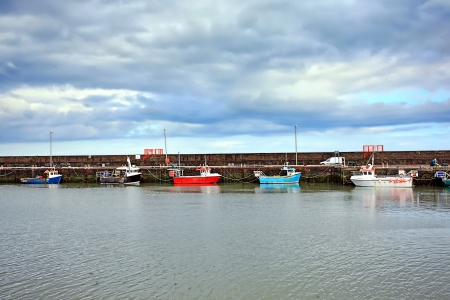 Old harbour in Arbroath in Scoltand photo