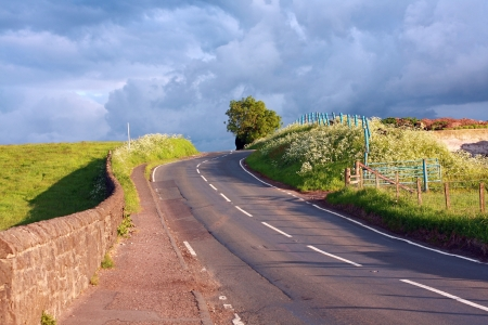 sunglight: Beautiful Scottish road in the countryside, Springtime  Stock Photo