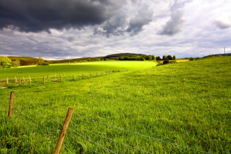 Scottish landscape with fields and hills on Spring afternoon  photo