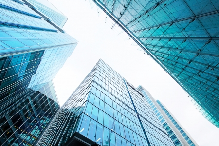 office window view: Modern glass silhouettes of skyscrapers in the city