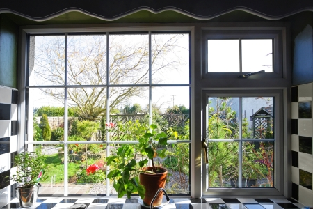 Pretty kitchen window with the view on garden  Stock Photo - 19669248