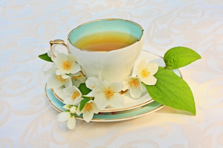Jasmine tea with jasmine flowers close up Stock Photo - 21158726