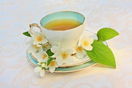 Jasmine tea with jasmine flowers close up Stock Photo - 21158726
