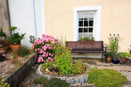 Old, traditional, scottish house and the garden photo