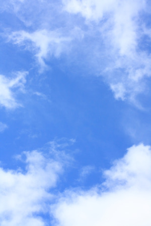 cloud background: Blue sky with white clouds, vertical
