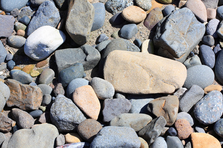 pebles: Pebbles background on the beach close up Stock Photo