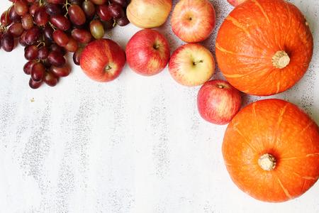 Ripe autumnal fruits on white background photo