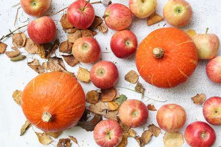 red juicy apples scattered on the white background photo
