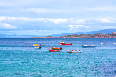 gaelic: Iona is a small island in the Inner Hebrides off the Ross of Mull on the western coast of Scotland. It was a centre of Gaelic monasticism for four centuries and is today renowned for its tranquility and natural beauty. It is a popular tourist destination