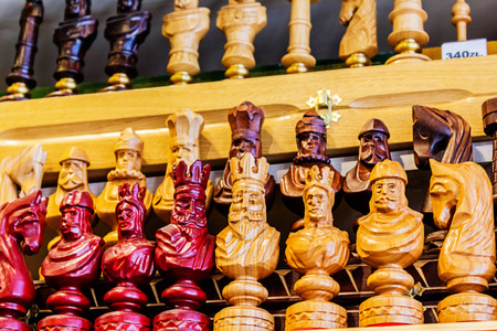 Close-up, detailed images of various chess pieces, queen, king, paws on sale in the shop Stock Photo