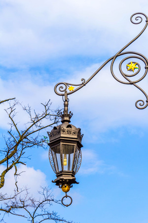 Beautiful old style street lamp at the Cloth Hall in Cracow, Poland, Europe Stock Photo