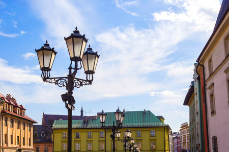 polska: The old, historical tenements at the Small Market Square in Cracow, Poland ( Krakow, Polska) Stock Photo