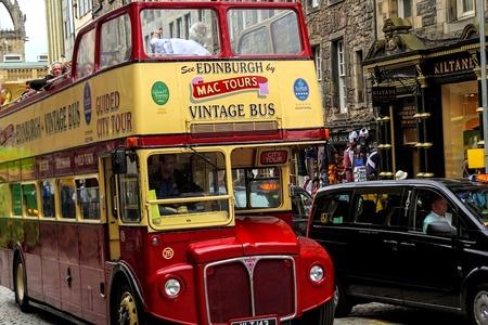 mile high city: EDINBURGH - 11 August, 2015, a vintage double decker tour bus on the Royal Mile in Edinburgh, Scotland.