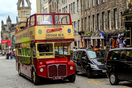 gb: EDINBURGH - 11 August, 2015, a vintage double decker tour bus on the Royal Mile in Edinburgh, Scotland.