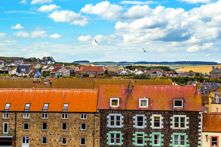 lothian: Rooftops of a small Scottish town and blue sky