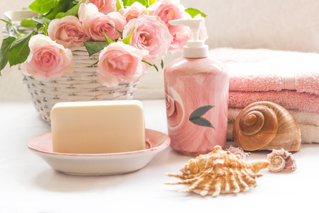 Pink roses, soap, towels and seashells arrangement Stock Photo
