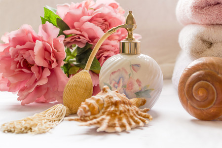 parfume: Bath arrangement with parfume bottle and pretty flowers Stock Photo