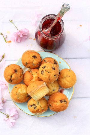 scones: Rustic wooden breakfast background with fresh scones and blooming cherry flowers