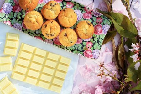 scones: Fresh Scottish scones and white chocolate with cherry blossom background Stock Photo