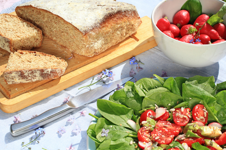 bread soda: Fresh, home baked soda bread on wooden cutting board, close up Stock Photo