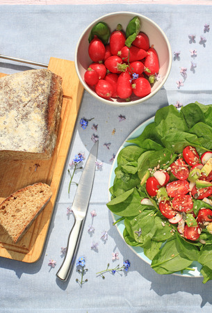 bread soda: Fresh, home baked soda bread on wooden cutting board and frehs vegetarian salad
