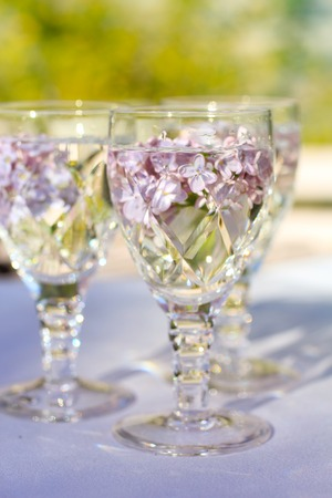lilac flowers: Lilac flowers in crystal wine glasses, close up