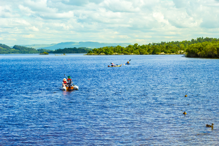 loch lomond: Water sports on calm blue Loch Lomond lake in Scotland Stock Photo