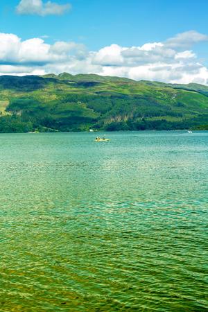loch lomond: Canoe on Loch Lomond in Luss, Scotland, UK