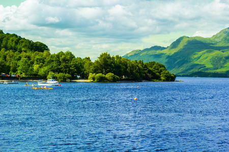 motor boat: People  on the motor boat at the Loch Lomond lake in Scotland