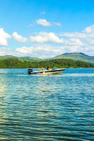 motor boat: People on the motor boat at Loch Lomond lake in Scotland