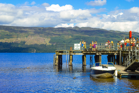 loch lomond: People having fun on a sunny day at the Luss Pier, Loch Lomond, Argylle and bute, Scotland Editorial