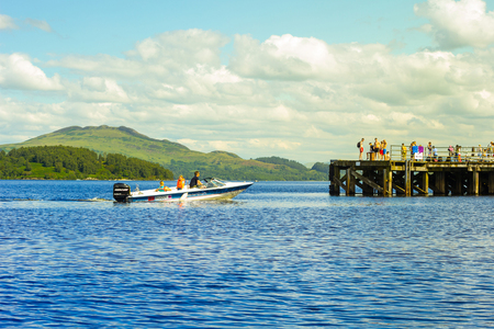 speed boat: Speed boat with tourists on Summer at Loch Lomond, Luss, Scotland, UK
