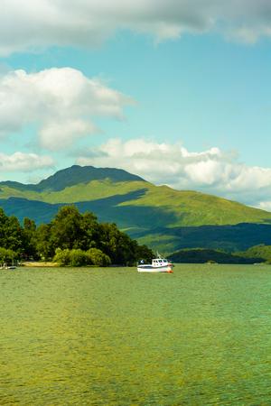 loch lomond: Boat on a sunny day at Loch Lomond lake in Scotland, UK Stock Photo