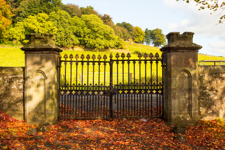 Old, beautiful iron gate at the old Scottish church in Autumn