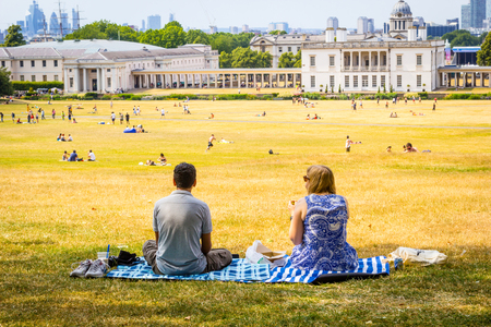A couple relaxing on a hot, sunny day on Primrose Hill in London, UK 写真素材
