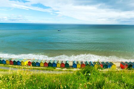 Beautiful view on the sea and beach huts in Whitby, Emgland, UK 写真素材 - 128779364
