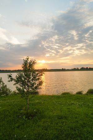 Beautiful sunset on the river orange sky