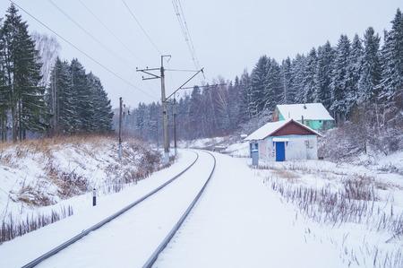 Winter rural landscape. Beautiful narrow gauge railway through snowy trees Stock Photo
