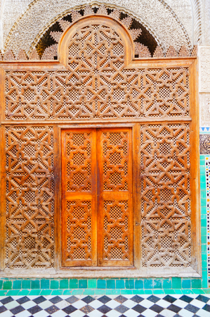 Old wooden door to the mosque in Arabic style